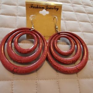 Crackled leather look round dangle earrings.